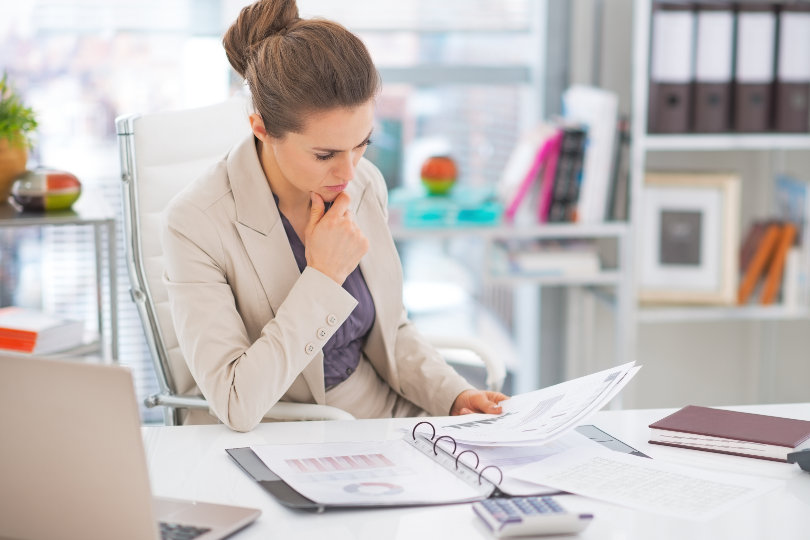 Business woman analyzing business reports