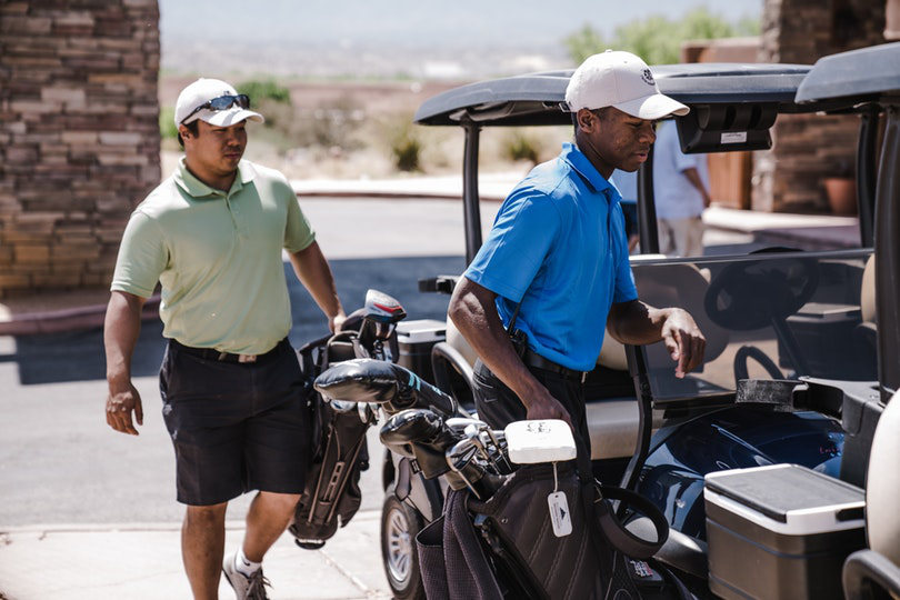 Golfer and caddy using golf course facility
